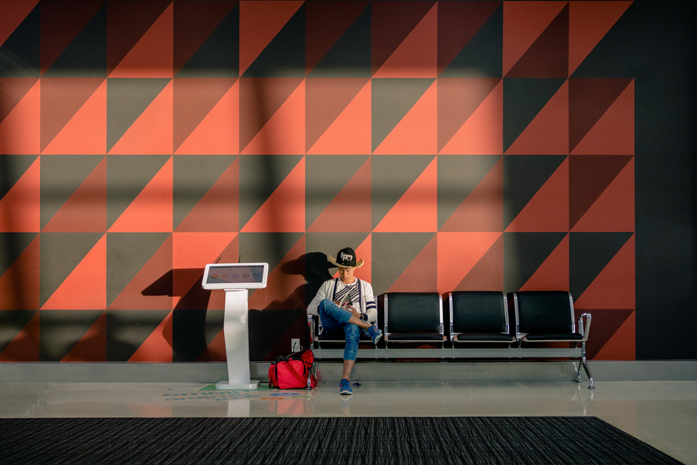 Last Photo of the trip and one of my favorites. Man waits for his plane at Auckland airport
